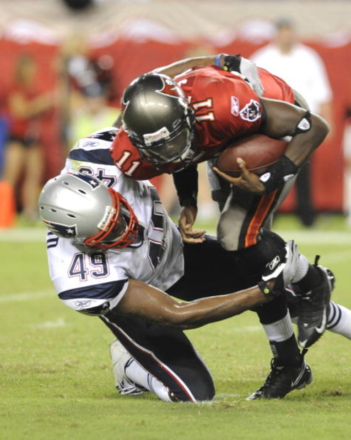 TAMPA, FL - AUGUST 17: Quarterback Josh Johnson #11 of the Tampa Bay Buccaneers is sacked by linebacker Vince Redd #49 of the New England Patriots at Raymond James Stadium on August 17, 2008 in Tampa, Florida. (Photo by Al Messerschmidt/Getty Images)