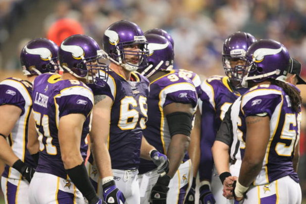 MINNEAPOLIS - SEPTEMBER 21:  Jared Allen #69, Ben Leber #51 and E.J. Henderson #56 of the Minnesota Vikings have a discussion against the Carolina Panthers during their NFL game at the Hubert H. Humphrey Metrodome on September 21, 2008 in Minneapolis, Min