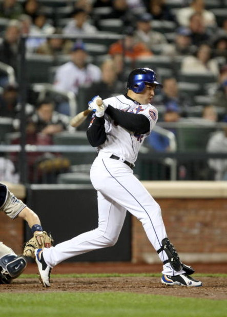 NEW YORK - APRIL 15:  Carlos Beltran of the New York Mets singles to score Daniel Murphy in the fourth inning to give the Mets a 1-0 lead over the San Diego Padres on April 15, 2009 at Citi Field in the Flushing neighborhood of the Queens borough of New Y
