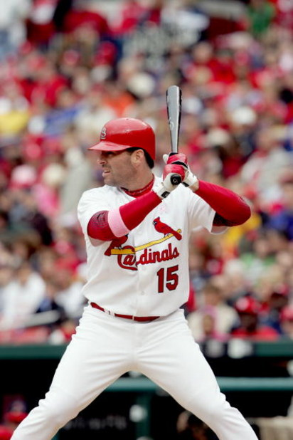 ST. LOUIS - MAY 14:  Jim Edmonds #15 of the St. Louis Cardinals bats against the Arizona Diamondbacks on May 14, 2006 at Busch Stadium in St. Louis, Missouri. The Diamondbacks defeated the St. Louis Cardinals 7-6. (Photo by Elsa/Getty Images)