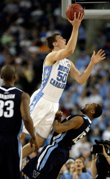 DETROIT - APRIL 04:  Tyler Hansbrough #50 of the North Carolina Tar Heels drives for a shot attempt in the second half against Reggie Redding #15 of the Villanova Wildcats during the National Semifinal game of the NCAA Division I Men's Basketball Champion