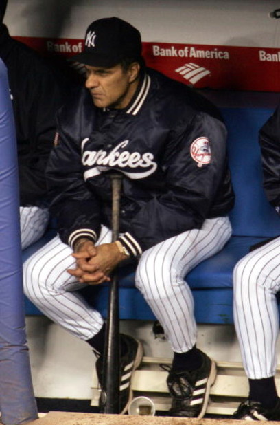 NEW YORK - OCTOBER 20:  Manager Joe Torre #6 of the New York Yankees watches from the dugout during the final outs of game seven of the American League Championship Series against the Boston Red Sox on October 20, 2004 at Yankee Stadium in the Bronx borou