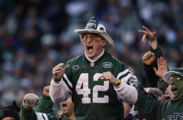 EAST RUTHERFORD, NJ - JANUARY 4:  Fireman Eddie leads the J.E.T.S. cheer for the New York Jets against the Indianapolis Colts during the AFC Wildcard Game at Giant Stadium on January 4, 2003 in East Rutherford, New Jersey. The Jets won 41-0. (Photo by Ezr