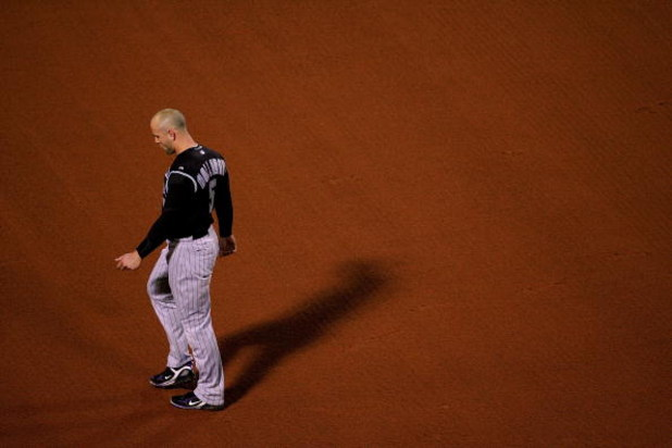 BOSTON - OCTOBER 24:  Matt Holliday #5 of the Colorado Rockies looks on after striking out to end the seventh inning against the Boston Red Sox during Game One of the 2007 Major League Baseball World Series at Fenway Park on October 24, 2007 in Boston, Ma