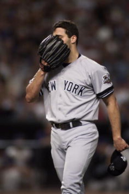 3 Nov 2001:  Andy Pettitte #46 of the New York Yankees walks off the mound after the first inning of game 6 of the World Series against the Arizona Diamondbacks at Bank One Ballpark in Phoenix, Arizona.  The Diamondbacks beat the Yankees 15-2 to force a g