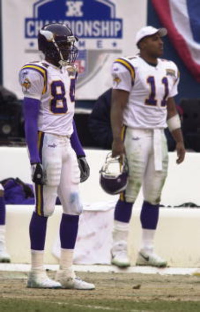 14 Jan 2001:  Randy Moss #84 and Daunte Culpepper #11 of the Minnesota Vikings stand dejected during the closing moments of the NFC Championship game against the New York Giants at Giants Stadium in East Rutherford, New Jersey. The Giants won 41-0. <Digit