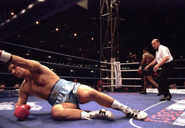 24 Jun 2000:  Lou Savarese attempts to get back to his feet during the heavyweight fight against Mike Tyson at Hampden Park in Glasgow, Scotland.  Mike Tyson won when the referee stopped the fight in the first round. \ Mandatory Credit: John Gichigi /Alls