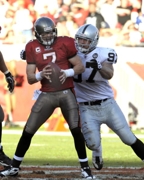 TAMPA, FL - DECEMBER 28: Defensive end Greyson Gunheim #97 of the Oakland Raiders sacks quarterback Jeff Garcia #7 of the Tampa Bay Buccaneers at Raymond James Stadium on December 28, 2008 in Tampa, Florida.  (Photo by Al Messerschmidt/Getty Images)