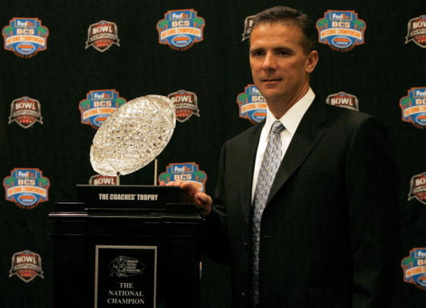 FORT LAUDERDALE, FL - JANUARY 07:  Head coach Urban Meyer of the Florida Gators poses with the 'The Coaches' Trophy' during the FedEx BCS Head Coaches Press Conference at Harbor Beach Marriott Resort & Spa on January 7, 2009 in Fort Lauderdale, Florida.