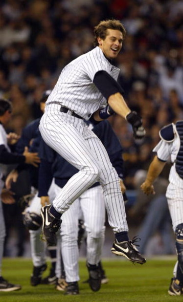 BRONX, NY - OCTOBER 16:  Aaron Boone #19 of the New York Yankees celebrates after hitting the game winning home run in the bottom of the eleventh inning against the Boston Red Sox during game 7 of the American League Championship Series on October 16, 200