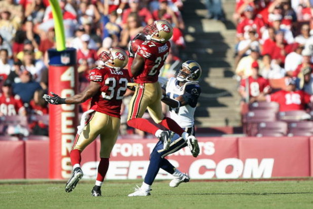 SAN FRANCISCO - NOVEMBER 16:  Walt Harris #27 of the San Francisco 49ers intercepts a pass as Michael Lewis #32 and Donnie Avery #17 of the St. Louis Rams look on during the game on November 16, 2008 at Candlestick Park in San Francisco, California. (Phot