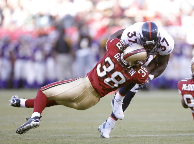 SAN FRANCISCO - AUGUST 13:  Running back Cecil Sapp #37 of the Denver Broncos is tackled by defensive back Dashon Goldson #38 of the San Francisco 49ers in a pre-season game at Monster Park August 13, 2007 in San Francisco, California.  (Photo by Greg Tro