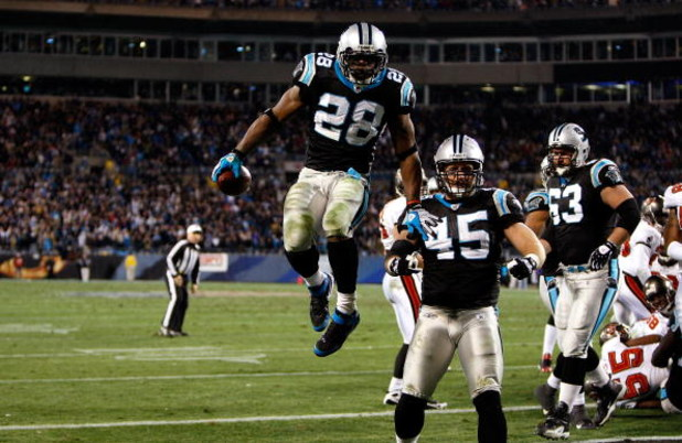 CHARLOTTE, NC - DECEMBER 08:  Jonathan Stewart  #28 of the Carolina Panthers celebrates with teammates after scoring a touchdown against the Tampa Bay Buccaneers at Bank of America Stadium on December 8, 2008 in Charlotte, North Carolina  (Photo by Street