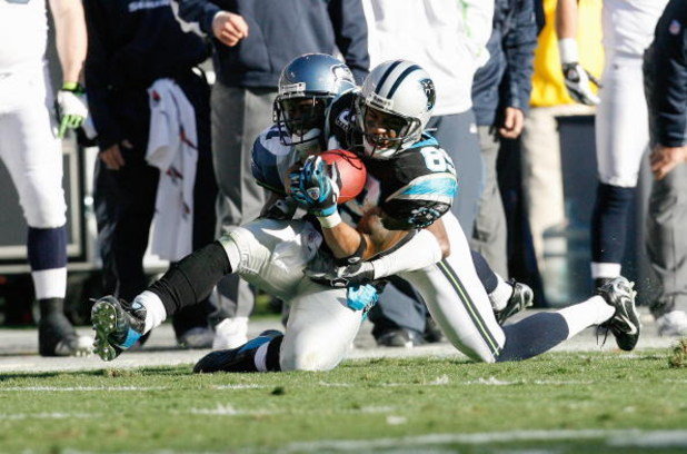 CHARLOTTE, NC - DECEMBER 16:  Steve Smith #89 of the Carolina Panthers catches the ball under pressure against the Seattle Seahawks during the second half at Bank of America Stadium on December 16, 2007 in Charlotte, North Carolina.  Carolina defeated Sea