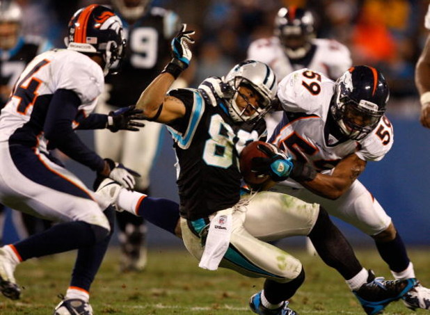 CHARLOTTE, NC - DECEMBER 14:  Wesley Woodyard #59 of the Denver Broncos tackles Steve Smith #89 of the Carolina Panthers during their game at Bank of America Stadium on December 14, 2008 in Charlotte, North Carolina  (Photo by Streeter Lecka/Getty Images)