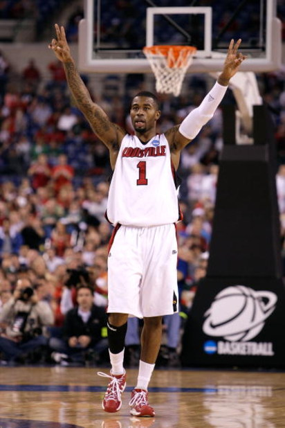 INDIANAPOLIS - MARCH 27:  Terrence Williams #1 of the Louisville Cardinals celebrates on court against the Arizona Wildcats during the third round of the NCAA Division I Men's Basketball Tournament at the Lucas Oil Stadium on March 27, 2009 in Indianapoli