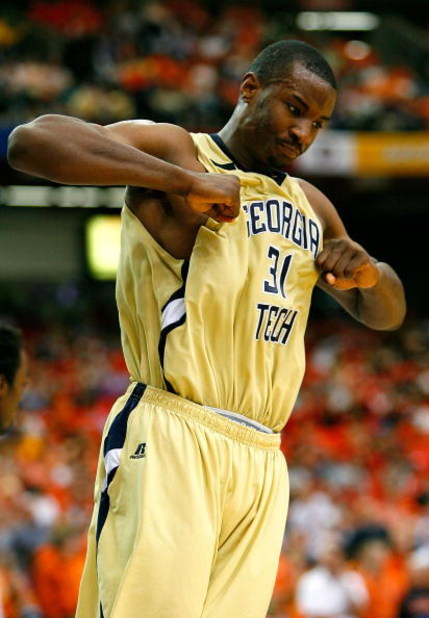 ATLANTA - MARCH 12:  Gani Lawal #31 of the Georgia Tech Yellow Jackets reacts after dunking against the Clemson Tigers during day one of the 2009 ACC Men's Basketball Tournament on March 12, 2009 at the Georgia Dome in Atlanta, Georgia.  (Photo by Kevin C