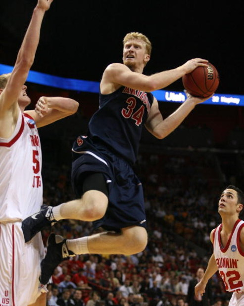 MIAMI - MARCH 20:  Forward Chase Budinger #34 (R) of the University of Arizona Wildcats takes a shot over  center Luke Nevill #50 (L) of the University of Utah Runnin' Utes  during the first round of the NCAA Division I Men's Basketball Tournament at the