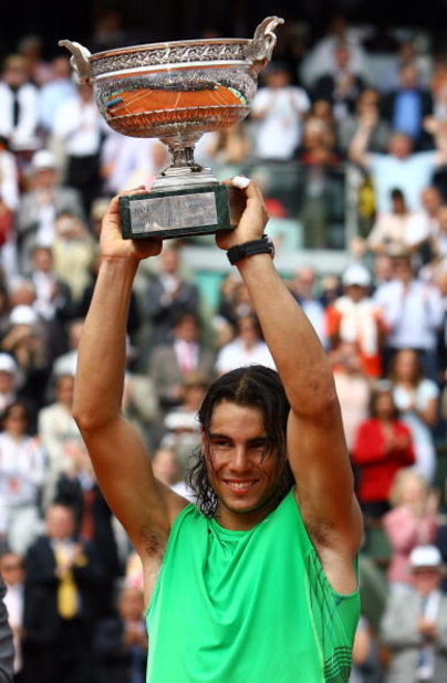 PARIS - JUNE 08:  Rafael Nadal of Spain lifts the trophy after defeating Roger Federer of Switzerland after the Men's Singles Final match on day fifteen of the French Open at Roland Garros on June 8, 2008 in Paris, France.  (Photo by Julian Finney/Getty I