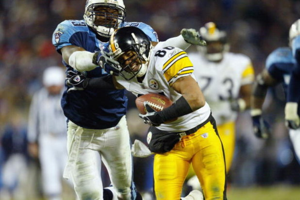 NASHVILLE, TN - JANUARY 11:  Hines Ward #86 of the Pittsburgh Steelers tries to evade the grasp of Keith Bulluck #53 of the Tennessee Titans during the AFC divisional playoff game at the Coliseum  on January 11, 2003 in Nashville, Tennessee.  The Titans w