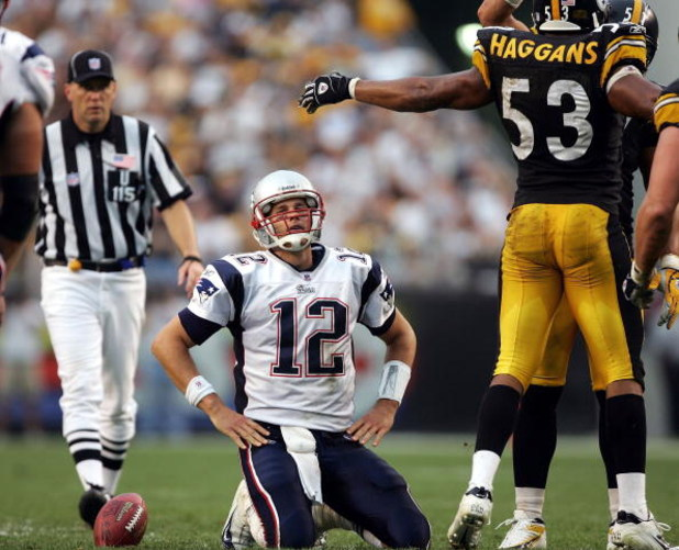 PITTSBURGH - SEPTEMBER 25:  Quarterback Tom Brady #12 of the New England Patriots reacts after a sack by linebacker Clark Haggans #53 of the Pittsburgh Steelers during the second quarter at Heinz Field on September 25, 2005 in Pittsburgh, Pennsylvania. Th