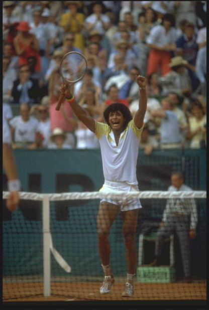 JUN 1983:  YANNICK NOAH OF FRANCE CELEBRATES AFTER WNNING THE MEN's SINGLES TITLE AT THE 1983 FRENCH OPEN GRAND SLAM.