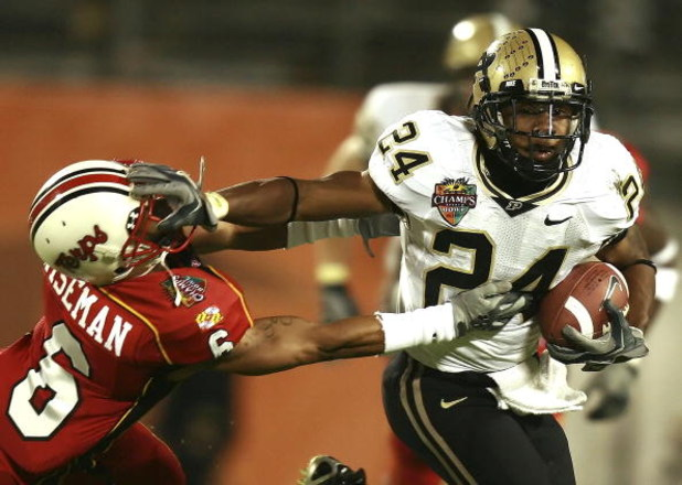 ORLANDO, FL - DECEMBER 29:  Running back Kory Sheets #24 of the Purdue Boilermakers tries to avoid a tackle attempt by cornerback Anthony Wiseman #6 of the Maryland Terrapins in the Champs Sports Bowl at Florida Citrus Bowl December 29, 2006 in Orlando, F