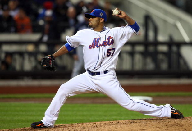 NEW YORK - MAY 11:  Johan Santana #57 of the New York Mets pitches against the Atlanta Braves on May 11, 2009 at Citi Field in the Flushing neighborhood of the Queens borough of New York City. The Braves defeated the Mets 8-3.  (Photo by Jim McIsaac/Getty