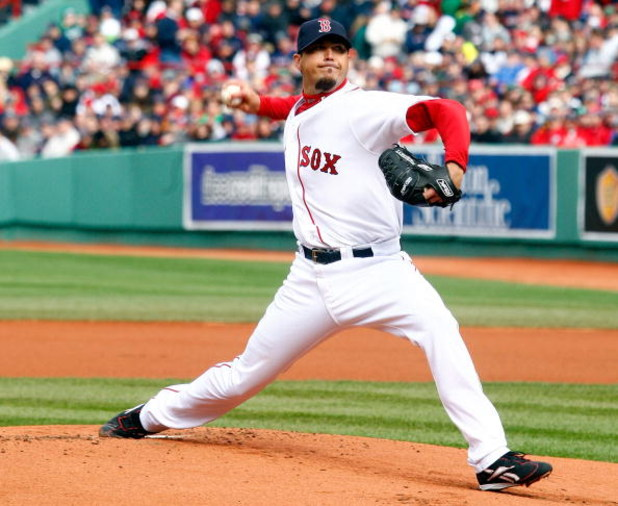 BOSTON - APRIL 7: Red Sox pitcher Josh Beckett #19 throws against the Tampa Bay Rays during an opening day game at Fenway Park April 7, 2009 in Boston, Massachusetts. (Photo by Jim Rogash/Getty Images)