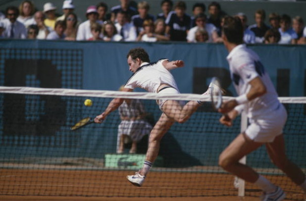 John McEnroe (left) and Ivan Lendl competing in the men's singles final of the Tournoi de Roland-Garros (French Open), at the Stade Roland Garros, Paris, June 1984. Lendl won the match 3-6, 2-6, 6-4, 7-5, 7-5. (Photo by Steve Powell/Getty Images)