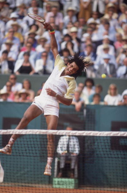 French tennis player Yannick Noah competes in the Men's Singles of the 1983 French Open. (Photo by Steve Powell/Getty Images)