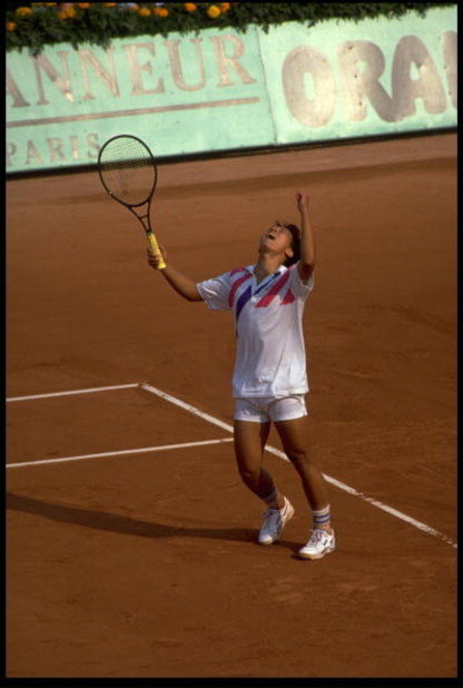 MAY 1989:  MICHAEL CHANG OF THE UNITED STATES CELEBRATES HIS WIN IN THE MEN's SINGLES AT THE 1989 FRENCH OPEN.