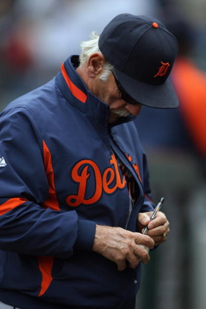 SEATTLE - APRIL 19:  Manager Jim Leyland of the Detroit Tigers signs a baseball before the game against the Seattle Mariners on April 19, 2009 at Safeco Field in Seattle, Washington. (Photo by Otto Greule Jr/Getty Images)