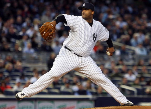 NEW YORK - MAY 19:  CC Sabathia #52 of the New York Yankees pitches against the Baltimore Orioles at Yankee Stadium May 19, 2009 in the Bronx borough of New York City.  (Photo by Jim McIsaac/Getty Images)