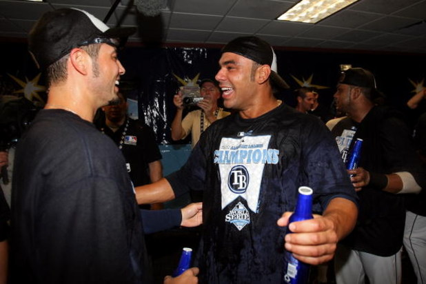ST PETERSBURG, FL - OCTOBER 19:  Carlos Pena #23 and Jason Bartlett (L) #8 of the Tampa Bay Rays celebrates after defeating the Boston Red Sox in game seven of the American League Championship Series during the 2008 MLB playoffs on October 19, 2008 at Tro