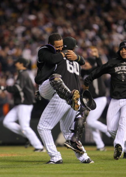 DENVER - OCTOBER 15:  Manny Corpas #60 and Yorvit Torrealba #8 of the Colorado Rockies celebrate their 6-4 win to advance to the World Series over the Arizona Diamondbacks during Game Four of the National League Championship Series at Coors Field on Octob