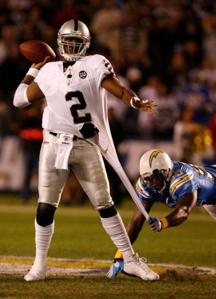 SAN DIEGO - DECEMBER 04:  Quarterback JaMarcus Russell #2 of the Oakland Raiders is grabbed by Linebacker Shaun Philips #95 of the San Diego Chargers during their NFL Game on December 4, 2008 at Qualcomm Stadium in San Diego, California.  (Photo by Harry