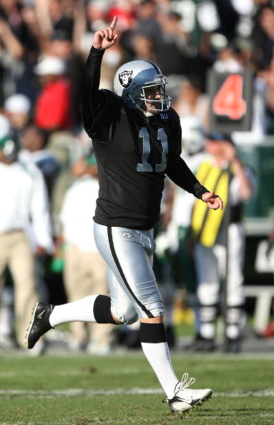 OAKLAND, CA - OCTOBER 19:  Sebastian Janikowski #11 of the Oakland Raiders celebrates after kicking a 57 yard field goal in overtime against the New York Jets during an NFL game on October 19, 2008 at the Oakland-Alameda County Coliseum in Oakland, Califo