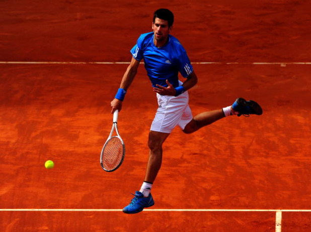 MADRID, SPAIN - MAY 16:  Novak Djokovic of Serbia leaps into the air smashing the ball to Rafael Nadal of Spain during his semi-final match against Rafael Nadal of Spain during the Madrid Open tennis tournament at the Caja Magica on May 16, 2009 in Madrid