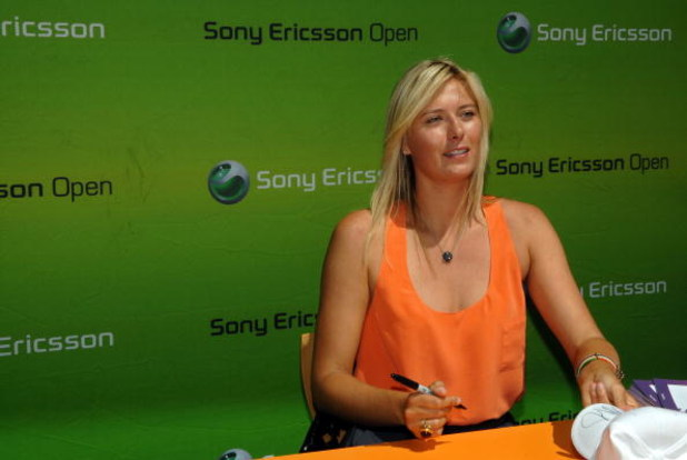 KEY BISCAYNE, FL - MARCH 26:  Maria Sharapova of Russia signs autographs for fans during day four of the Sony Ericsson Open at the Crandon Park Tennis Center on March 26, 2009 in Key Biscayne, Florida.  (Photo by Michael Heiman/Getty Images)
