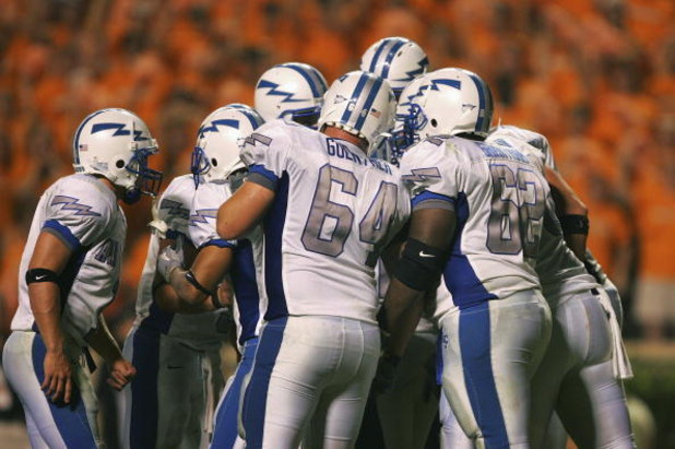 KNOXVILLE, TN - SEPTEMBER 9:    The Air Force Academy Falcons offense huddles just before scoring their final touchdown against the University of Tennessee Volunteers on September 9, 2006 at Neyland Stadium in Knoxville, Tennessee. Tennessee won 31-30.  (