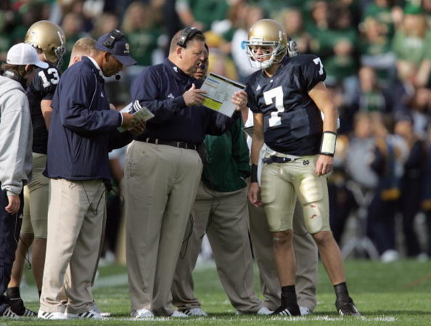 SOUTH BEND, IN - OCTOBER 13: Head coach Charlie Weis of the Notre Dame Fighting Irish talks with Jimmy Clausen #7 during the game against  the Boston College Eagles on October 13, 2007 at Notre Dame Stadium in South Bend, Indiana. (Photo by Jonathan Danie