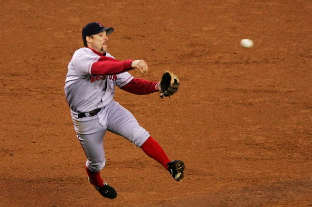 NEW YORK - OCTOBER 20:  Bill Mueller #11 of the Boston Red Sox throws out Alex Rodriguez #13 on a groundball play in the first inning during game seven of the American League Championship Series on October 20, 2004 at Yankee Stadium in the Bronx borough o