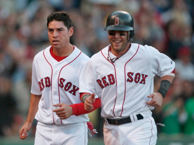 BOSTON - SEPTEMBER 15:  Jacoby Ellsbury #46 and Dustin Pedroia #15 of the Boston Red Sox react after scoring in the sixth inning during a game against the New York Yankees on September 15, 2007 at Fenway Park in Boston, Massachusetts.  (Photo by Jim Rogas