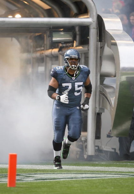 SEATTLE - OCTOBER 12:  Sean Locklear #75 of the Seattle Seahawks jogs out onto the field prior to the game against the Green Bay Packers on October 12, 2008 at Qwest Field in Seattle, Washington. The Packers defeated the Seahawks 27-17. (Photo by Otto Gre
