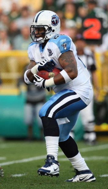 GREEN BAY, WI - AUGUST 28: LenDale White #25 of the Tenessee Titans runs for yardage against the Green Bay Packers on August 28, 2008 at Lambeau Field in Green Bay, Wisconsin. The Titans defeated the Packers 23-21. (Photo by Jonathan Daniel/Getty Images)