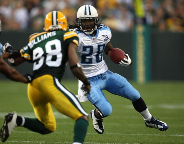 GREEN BAY, WI - AUGUST 28: Chris Johnson #28 of the Tenessee Titans runs against Tramon Williams #38 of the Green Bay Packers on August 28, 2008 at Lambeau Field in Green Bay, Wisconsin. (Photo by Jonathan Daniel/Getty Images)