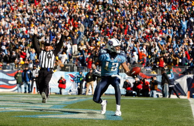 NASHVILLE, TN - DECEMBER 21:  Justin Gage #12 of the Tennessee Titans celebrates after scoring a touchdown against the Pittsburgh Steelers during their game on December 21, 2008 at LP Field in Nashville, Tennessee.  (Photo by Streeter Lecka/Getty Images)