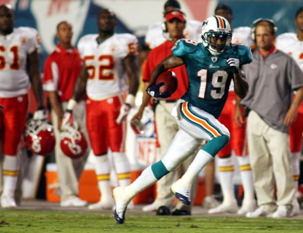 MIAMI - AUGUST 23:  Punt returner Ted Ginn Jr. #19 of the Miami Dolphinsruns for a 59 yard touchdown return during a pre season game against the Kansas City Chiefs on August 23, 2008 at Dolphin Stadium in Miami, Florida.  (Photo by Marc Serota/Getty Image