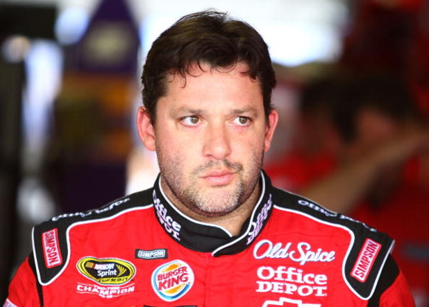 CONCORD, NC - MAY 23:  Tony Stewart, driver of the #14 Office Depot/Old Spice Chevorlet, walks out of the garage area during practice for the NASCAR Sprint Cup Series Coca-Cola 600 on May 23, 2009 at Lowe's Motor Speedway in Concord, North Carolina.  (Pho